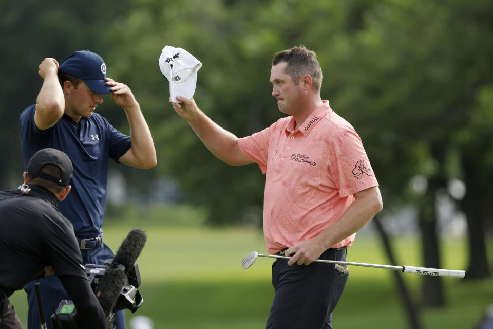 Jason Kokrak, celebrates his victory in the Charles Schwab Challenge golf tournament at the Colonial Country Club in Fort Worth, Texas Sunday, May 30, 2021, as Jordan Spieth, left, walks off. (AP Photo/Michael Ainsworth)
