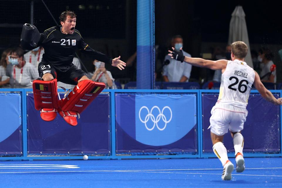 <p>Vincent Vanasch and Victor Nicky B Wegnez of Belgium celebrate after Vanasch blocked a fifth penalty retake shot by Jacob Thomas Whetton of Australia in the penalty shootout during the men's gold medal match.</p>