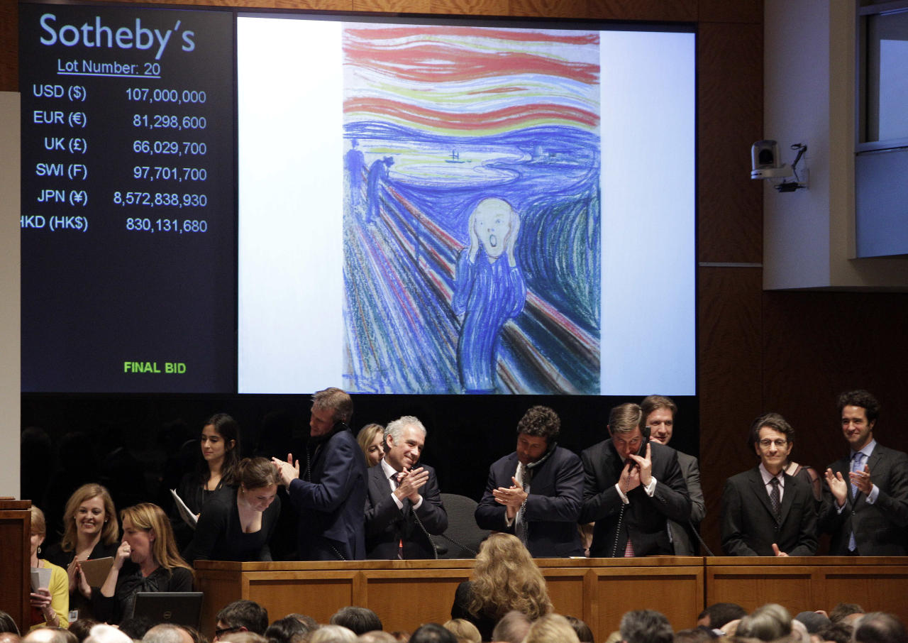 "Edvard Munch's ""The Scream"" is auctioned at Sotheby's Wednesday, May 2, 2012, in New York. The image is one of four versions created by the Norwegian expressionist painter. Three are in Norwegian museums. The one at the Sotheby's auction is the only one left in private hands. It is being sold by Norwegian businessman Petter Olsen, whose father was a friend and patron of the artist. The hammer price was $107 Million with the buyers premium the price is $119,922, 500. (AP Photo/Frank Franklin II)"