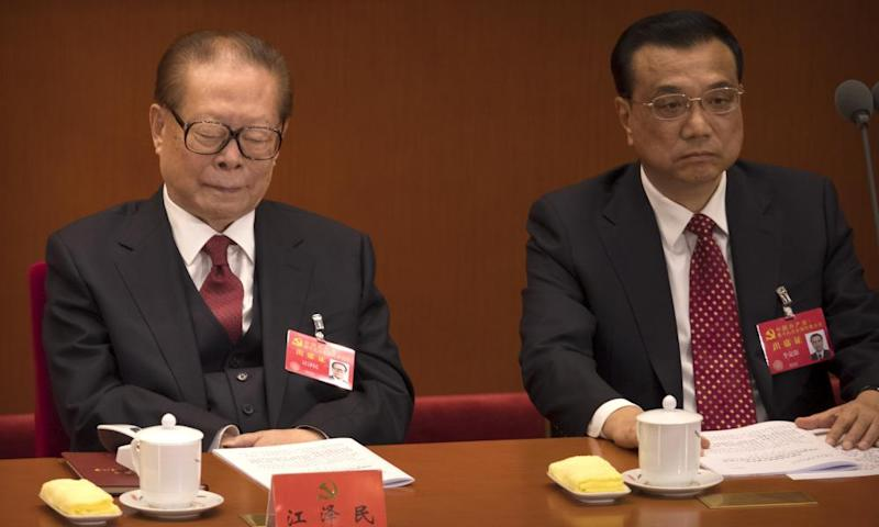 Jiang Zemin, left, with Premier Li Keqiang, struggles to keep awake during Xi Jinping's three-and-a-half-hour speech to the 19th party congress in Beijing.