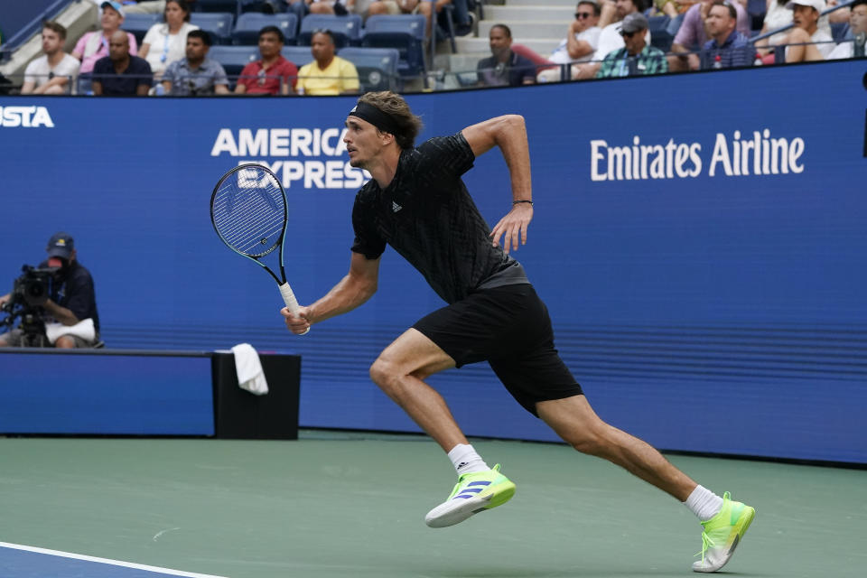 Alexander Zverev, of Germany, chases down a shot from Lloyd Harris, of South Africa, during the quarterfinals of the US Open tennis championships, Wednesday, Sept. 8, 2021, in New York. (AP Photo/Elise Amendola)