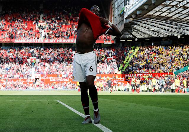 "Soccer Football - Premier League - Manchester United vs Watford - Old Trafford, Manchester, Britain - May 13, 2018 Manchester United's Paul Pogba removes his shirt after the match REUTERS/Darren Staples EDITORIAL USE ONLY. No use with unauthorized audio, video, data, fixture lists, club/league logos or ""live"" services. Online in-match use limited to 75 images, no video emulation. No use in betting, games or single club/league/player publications. Please contact your account representative for further details."