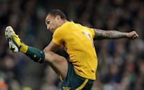 Australian Wallabies' Quade Cooper kicks a conversion during a rugby union Test match in Dublin, on November 16, 2013 (AFP Photo/Peter Muhly)