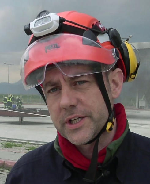 """FILE - In this image taken from file video, showing James Le Mesurier, founder and director of Mayday Rescue, talks to the media during training exercises in southern Turkey, March 19, 2015.  Turkey's state-run news agency report Monday Nov. 11, 2019, that a former British army officer who helped found the """"White Helmets"""" volunteer organisation in Syria, has been found dead in Istanbul. (AP Photo, FILE)"""