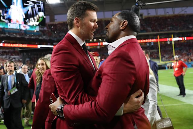 Tom Brady of the New England Patriots talks with NFL Hall of Famer Ray Lewis of the Baltimore Ravens prior to Super Bowl LIV between the San Francisco 49ers and the Kansas City Chiefs at Hard Rock Stadium on February 02, 2020 in Miami, Florida. (Photo by Maddie Meyer/Getty Images)