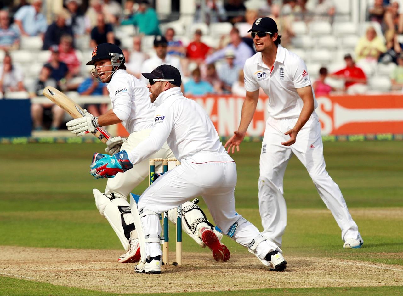 Essex batsman Mark Pettini (left) hits out during day two of the International Warm up match at The County Ground, Chelmsford.
