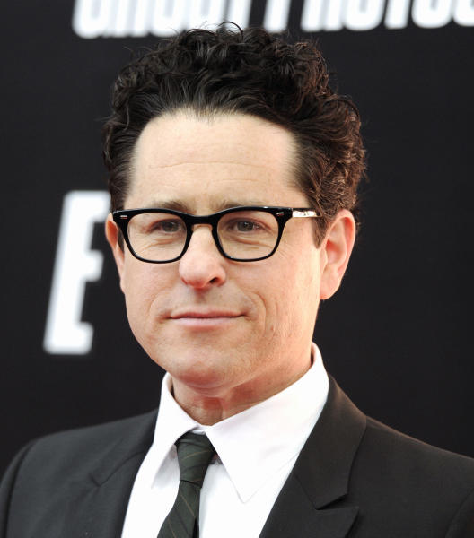 """FILE - This Dec. 19, 2011 file photo shows producer J.J. Abrams attending the U.S. premiere of """"Mission: Impossible - Ghost Protocol,"""" at the Ziegfeld Theatre in New York. Abrams' latest series, """"Revolution,"""" tells of a world 15 years after the world inexplicably suffers a power outage. Every gadget, light source, communications means and motor vehicle is the victim of a seemingly permanent blackout. It airs Mondays at 10 p.m. EDT on NBC. (AP Photo/Evan Agostini, file)"""