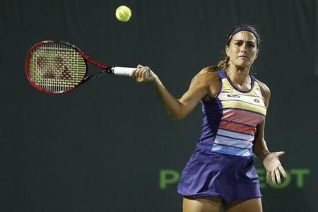 Mar 23, 2018; Key Biscayne, FL, USA; Monica Puig of Puerto Rico hits a forehand against Caroline Wozniacki of Denmark (not pictured) on day four of the Miami Open at Tennis Center at Crandon Park. Mandatory Credit: Geoff Burke-USA TODAY Sports