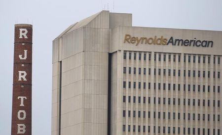 The headquarters of Reynolds American is seen with old R.J. Reynolds Tobacco smoke stacks from a previous manufacturing plant in downtown Winston-Salem