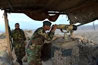 Security forces watch over the area from remote outposts