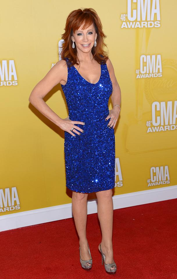 "<p class=""MsoNormal""><span style=""color:black;"">Reba McEntire, who, in case you didn't know has been going simply by ""Reba"" (a la Madonna or Cher) since 1984, dazzled in super-sequined royal blue mini, which she paired with peep-toe pumps. We don't know about you, but if we have half as svelte of a figure as the Queen of Country does at age 57, we'll be thrilled! (11/1/2012)<br></span></p>"
