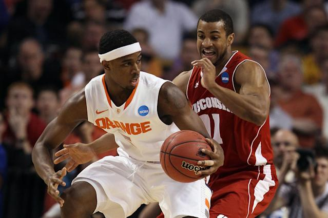 BOSTON, MA - MARCH 22: C.J. Fair #5 of the Syracuse Orange handles the ball against Jordan Taylor #11 of the Wisconsin Badgers during their 2012 NCAA Men's Basketball East Regional Semifinal game at TD Garden on March 22, 2012 in Boston, Massachusetts. (Photo by Elsa/Getty Images)
