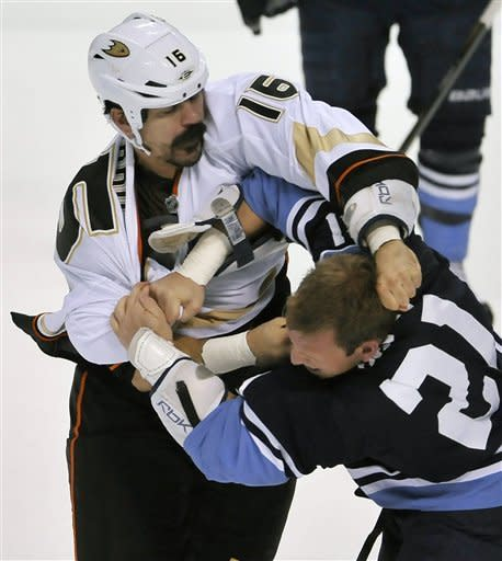 Anaheim Ducks' George Parros (16) fights with Florida Panthers' Krystofer Barch (21) during the first period of an NHL hockey game on Sunday, Feb. 19, 2012 in Sunrise, Fla. (AP Photo/Gary I Rothstein)