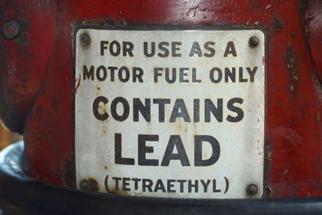 A sign on a vintage gasoline pump advises that the gas contains lead (tetraethyl). (Photo: Robert Alexander via Getty Images)