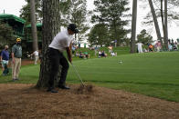 Patrick Reed hits out of the pine straw on the 10th hole during the second round of the Masters golf tournament on Friday, April 9, 2021, in Augusta, Ga. (AP Photo/Gregory Bull)