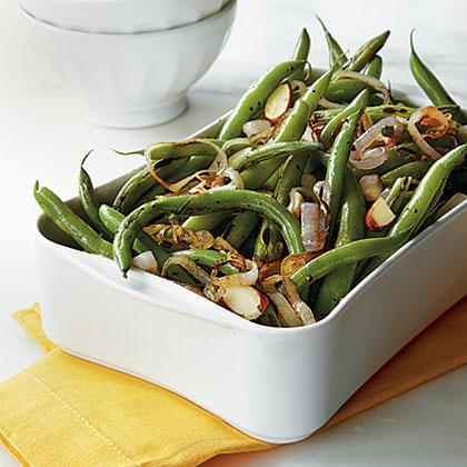 """<p>It's hard to beat a bumper crop of <a href=""""https://www.myrecipes.com/ingredients/vegetable-recipes/simple-green-bean-recipe-ideas"""" rel=""""nofollow noopener"""" target=""""_blank"""" data-ylk=""""slk:fresh green beans"""" class=""""link rapid-noclick-resp"""">fresh green beans</a> from local farmers, and a simple preparation is the best way to highlight their delicious natural flavor. Toast the <a href=""""https://www.myrecipes.com/ingredients/almond-recipes"""" rel=""""nofollow noopener"""" target=""""_blank"""" data-ylk=""""slk:almonds"""" class=""""link rapid-noclick-resp"""">almonds</a> in a little unsalted butter, then toss the green beans and almonds with a splash of lemon juice and dash of salt and ground black pepper for an easy summer side. </p>"""