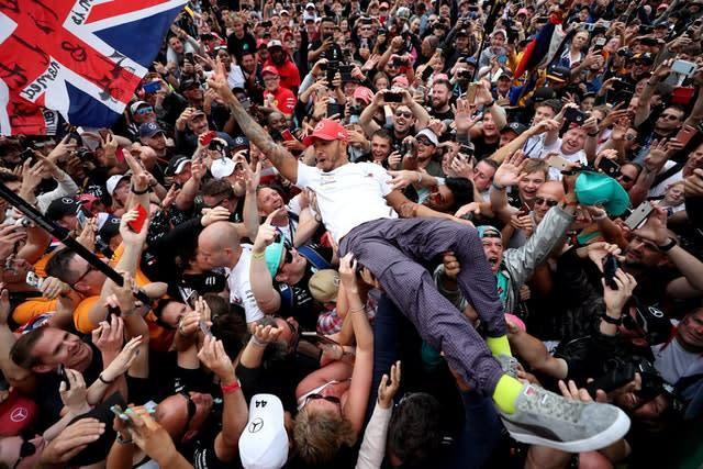 Lewis Hamilton celebrates his victory with the crowd after the British Grand Prix at Silverstone in 2019 (David Davies/PA)