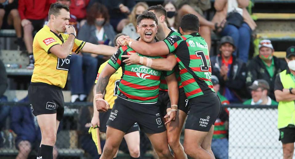Latrell Mitchell of the Rabbitohs celebrates scoring a try during the round 19 NRL match between the South Sydney Rabbitohs and the New Zealand Warriors at Sunshine Coast Stadium.