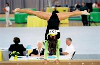 """<p>At an invitational competition, Haley is overwhelmed by emotion during her beam routine. She falls and gets through the rest of her routine (a watered down version) amid tears - as Frank (<a class=""""link rapid-noclick-resp"""" href=""""https://www.popsugar.com/Kellan-Lutz"""" rel=""""nofollow noopener"""" target=""""_blank"""" data-ylk=""""slk:Kellan Lutz"""">Kellan Lutz</a>) says, """"You tanked like a rock star."""" Prior to her performance, she finds out that her dad (Jon Gries) is presumably paying off Burt Vickerman (<a class=""""link rapid-noclick-resp"""" href=""""https://www.popsugar.com/Jeff-Bridges"""" rel=""""nofollow noopener"""" target=""""_blank"""" data-ylk=""""slk:Jeff Bridges"""">Jeff Bridges</a>) to let her go to VGA. To top it all off, her mom (Gia Carides) selfishly asks her to return to training with Chris DeFrank (John Kapelos), Haley's former coach who essentially split her family up when he had an affair with her mom.</p> <p>It is a defining moment in the movie where we see Haley's past come flooding back and challenge her dedication to the sport. It's when we find out why she really quit gymnastics in the first place and walked out on the World Championships two years prior. Seeing stoic and headstrong Haley with tear-stained cheeks has always stuck with me as a reminder that you never really know what people are going through. <a href=""""http://www.youtube.com/watch?v=Gufyc-xmJuo"""" class=""""link rapid-noclick-resp"""" rel=""""nofollow noopener"""" target=""""_blank"""" data-ylk=""""slk:Watch that routine here"""">Watch that routine here</a>.</p>"""