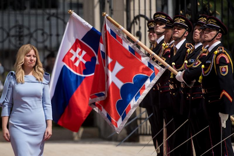 """Caputova, reviewing the guard of honour during her inauguration ceremony, compaigned under the slogan """"Stand up to evil"""" yet the community activist had previously been largely unknown (AFP Photo/VLADIMIR SIMICEK)"""