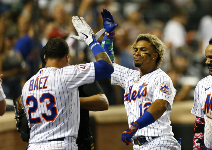 New York Mets' Javier Baez (23) congratulates Francisco Lindor after he hit a home run against the New York Yankees during the eighth inning of a baseball game on Sunday, Sept. 12, 2021, in New York. (AP Photo/Noah K. Murray)