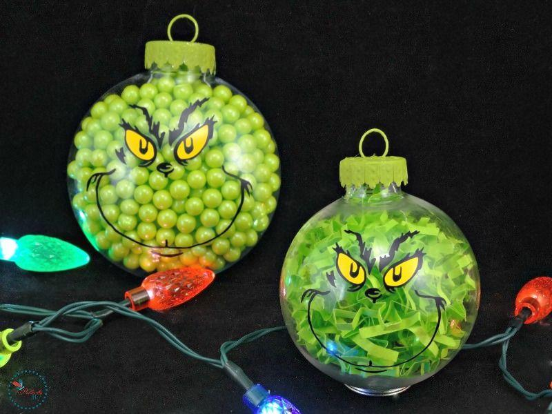 "<p>Fill plain plastic ornaments with green candy or paper shreds and add a vinyl Grinch face to add some festive spirit to your tree.<br></p><p><strong>Get the tutorial at <a href=""https://bullocksbuzz.com/two-diy-grinch-christmas-ornaments/"" rel=""nofollow noopener"" target=""_blank"" data-ylk=""slk:Bullock's Buzz"" class=""link rapid-noclick-resp"">Bullock's Buzz</a>.</strong></p><p><strong><a class=""link rapid-noclick-resp"" href=""https://www.amazon.com/Sea-Team-Shatterproof-Artificial-Decorations/dp/B07GD8ZHKN/ref=sr_1_26?dchild=1&keywords=clear+plastic+ornaments+balls+FOOD+SAFE&qid=1603062998&sr=8-26&tag=syn-yahoo-20&ascsubtag=%5Bartid%7C10050.g.28982778%5Bsrc%7Cyahoo-us"" rel=""nofollow noopener"" target=""_blank"" data-ylk=""slk:SHOP PLASTIC ORNAMENTS"">SHOP PLASTIC ORNAMENTS</a><br></strong></p>"