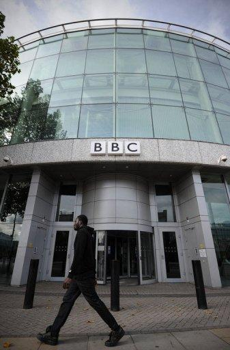 A man walks past one of the entrances to the BBC Television Centre in west London in 2011. The BBC was in turmoil on Sunday after its director-general dramatically quit over a broadcast by the British broadcaster's flagship news show that wrongly accused a politician of child sex abuse