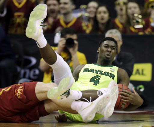 Baylor guard Mario Kegler (4) lands on the floor after being fouled by Iowa State forward Michael Jacobson, left, during the first half of an NCAA college basketball game in the quarterfinals of the Big 12 conference tournament in Kansas City, Mo., Thursday, March 14, 2019. (AP Photo/Orlin Wagner)
