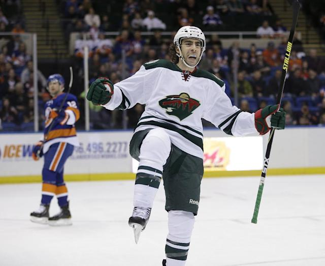 Minnesota Wild's Matt Moulson celebrates after scoring during the first period of the NHL hockey game against the New York Islanders, Tuesday, March 18, 2014, in Uniondale, New York. (AP Photo/Seth Wenig)