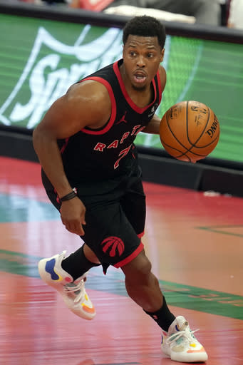 Toronto Raptors guard Kyle Lowry (7) works the ball up the floor during the second half of an NBA basketball game against the Dallas Mavericks Monday, Jan. 18, 2021, in Tampa, Fla. (AP Photo/Chris O'Meara)