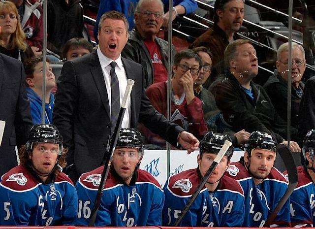 Colorado Avalanche head coach Patrick Roy yells against the Minnesota Wild during the second period of an NHL hockey game on Saturday, Nov. 30, 2013, in Denver. (AP Photo/Jack Dempsey)