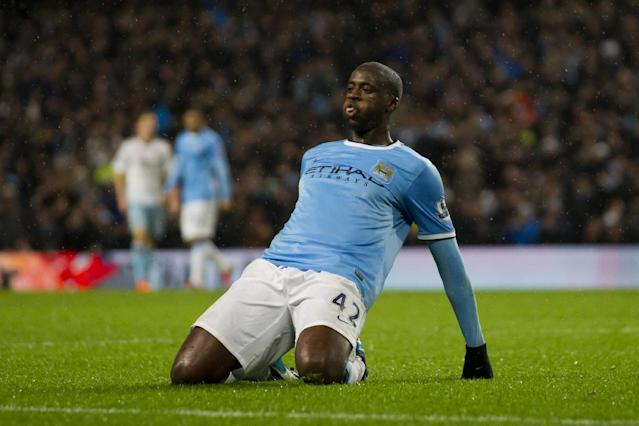 Manchester City's Yaya Toure celebrates after scoring against West Ham during their English League Cup semi-final soccer match at the Etihad Stadium, Manchester, England, Wednesday Jan. 8, 2014. (AP Photo/Jon Super)