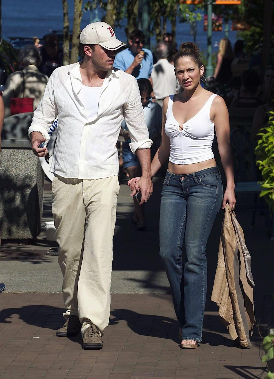 <p>For a summer outing in 2003, Ben chose a monochromatic palette, while Jennifer showed off a quintessential early aughts look in low-rise jeans and a belly-baring tank. </p>
