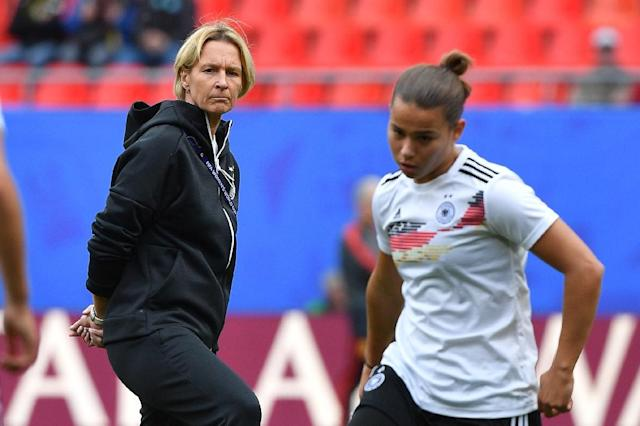 Germany's coach Martina Voss-Tecklenburg is concerned that a semi-final place may not be enough for her team to secure Olympic qualification (AFP Photo/Philippe HUGUEN)