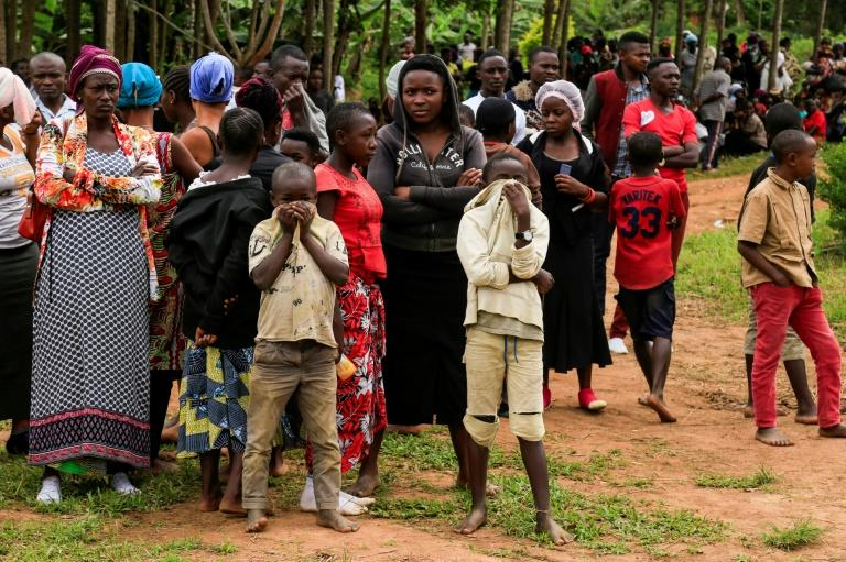 People gather in the eastern DR Congo town of Oicha in November 2019 after the latest attack attributed to the the Allied Democratic Forces, a militia whose leaders have been slapped by sanctions by the United States (AFP Photo/Bienvenu-Marie BAKUMANYA)