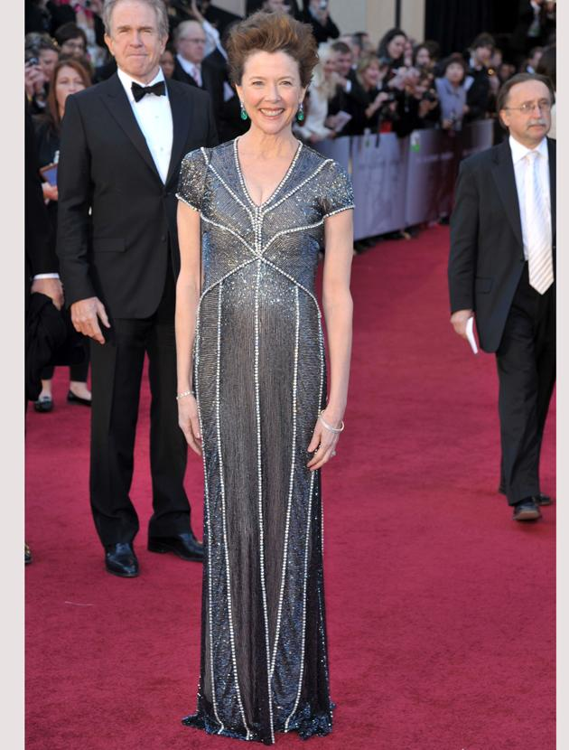 Oscars 2011 photos: Annette Benning looked elegant in a beaded and sequined grey gown.