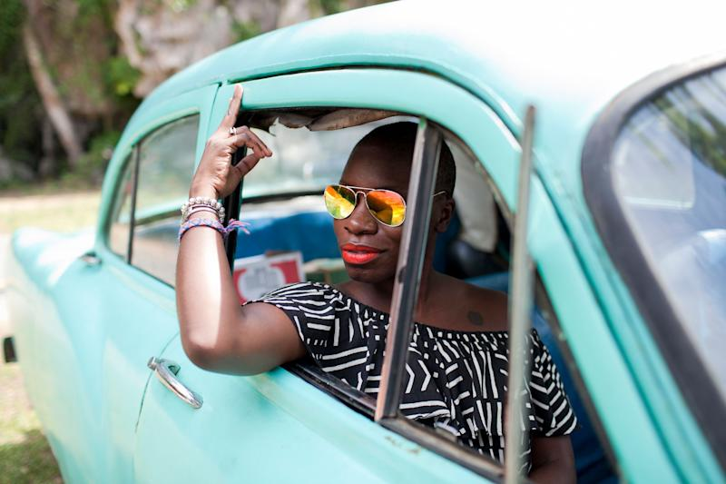 Jessica Nabongo is a red-lipped cutie in Cuba. (Photo: James Bland)