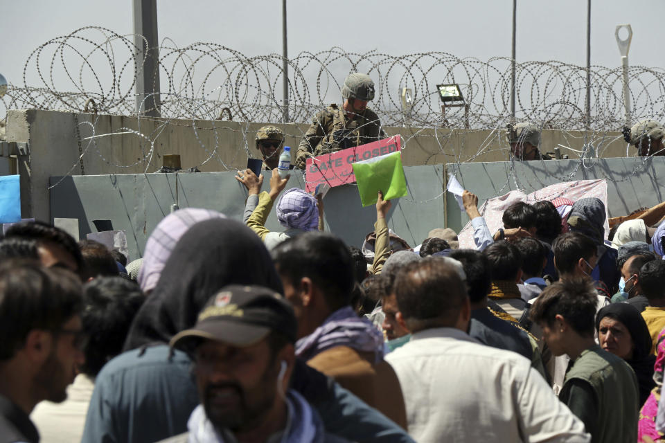 Crowds gathered in their hundreds at checkpoints outside Kabul's airport during the evacuations in August (Wali Sabawoon/AP)