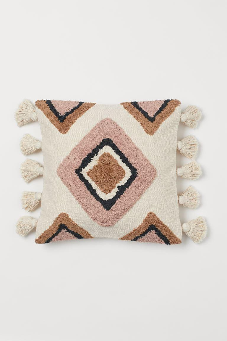 "<p>The pattern on this <a href=""https://www.popsugar.com/buy/HampM-Cushion-Cover-Tassels-584971?p_name=H%26amp%3BM%20Cushion%20Cover%20with%20Tassels&retailer=www2.hm.com&pid=584971&price=30&evar1=casa%3Aus&evar9=45784601&evar98=https%3A%2F%2Fwww.popsugar.com%2Fhome%2Fphoto-gallery%2F45784601%2Fimage%2F47575735%2FHM-Cushion-Cover-with-Tassels&list1=shopping%2Cproducts%20under%20%2450%2Cdecor%20inspiration%2Caffordable%20shopping%2Chome%20shopping&prop13=api&pdata=1"" class=""link rapid-noclick-resp"" rel=""nofollow noopener"" target=""_blank"" data-ylk=""slk:H&amp;M Cushion Cover with Tassels"">H&amp;M Cushion Cover with Tassels</a> ($30) is so fun.</p>"