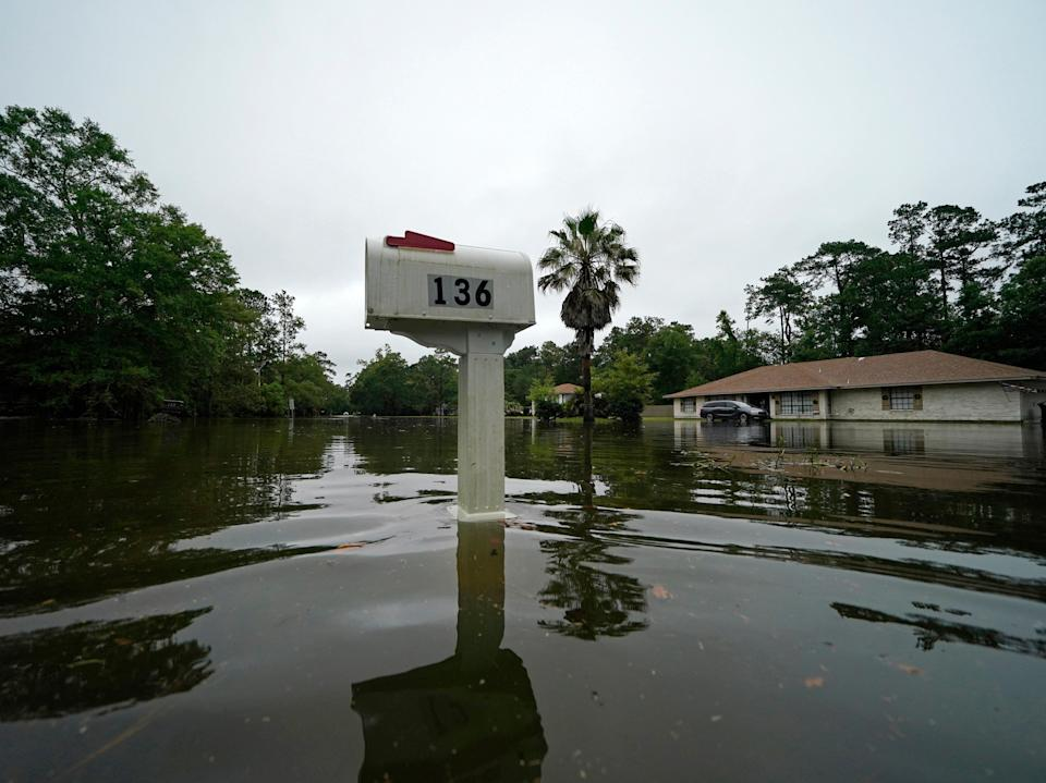 A flooded neighbourhood is seen after Tropical Storm Claudette passed through in Slidell, Louisiana on 19 Saturday June 2021 (AP)