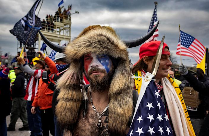 <p>'QAnon Shaman' Jacob Chansley infamously wore an animal headdress to the 6 January Capitol riot</p> (Getty Images)