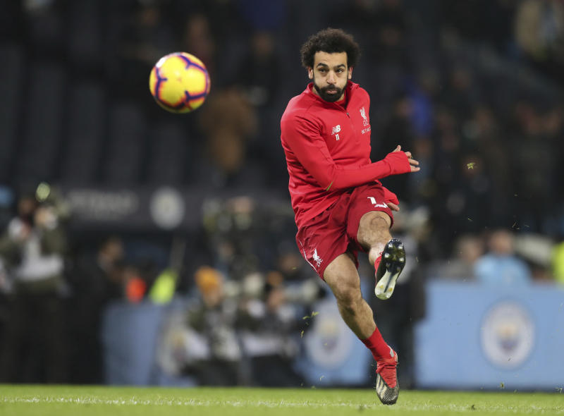 Liverpool's Mohamed Salah takes a shot as he warms up ahead of the English Premier League soccer match between Manchester City and Liverpool at the Ethiad stadium, Manchester England, Thursday, Jan. 3, 2019. (AP Photo/Jon Super)