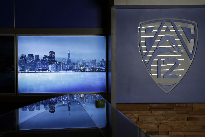 FILE - In this July 17 2012, file photo, an image of the San Francisco skyline is projected in the main studio of the Pac-12 television network in San Francisco. The Pac-12 is launched its own TV network this season, following a template set up by the Big Ten in 2007 that has yielded millions of dollars for its teams during the past five years.(AP Photo/Marcio Jose Sanchez, File)