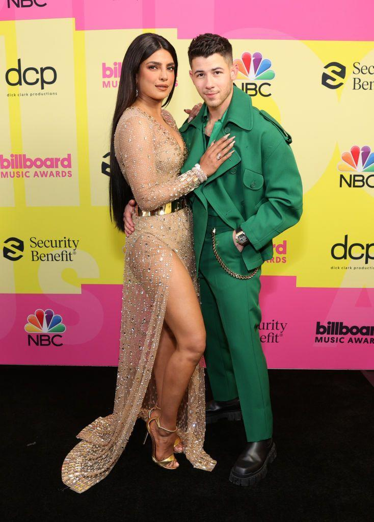 <p>The couple attended the 2021 Billboard Music Awards in Los Angeles on May 24 where Nick Jonas co-hosted the show and performed with the Jonas Brothers.</p><p>Cuddling up on the red carpet, Chopra wore a custom Dolce & Gabbana sheer gown with embroidered diamonds and Bulgari jewellery while Jonas wore a green suit and jacket by Fendi.</p>