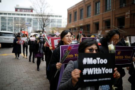 Women march during a protest as a part of the #MeToo movement on International Women's Day in Seoul, South Korea, March 8, 2018.   REUTERS/Kim Hong-Ji