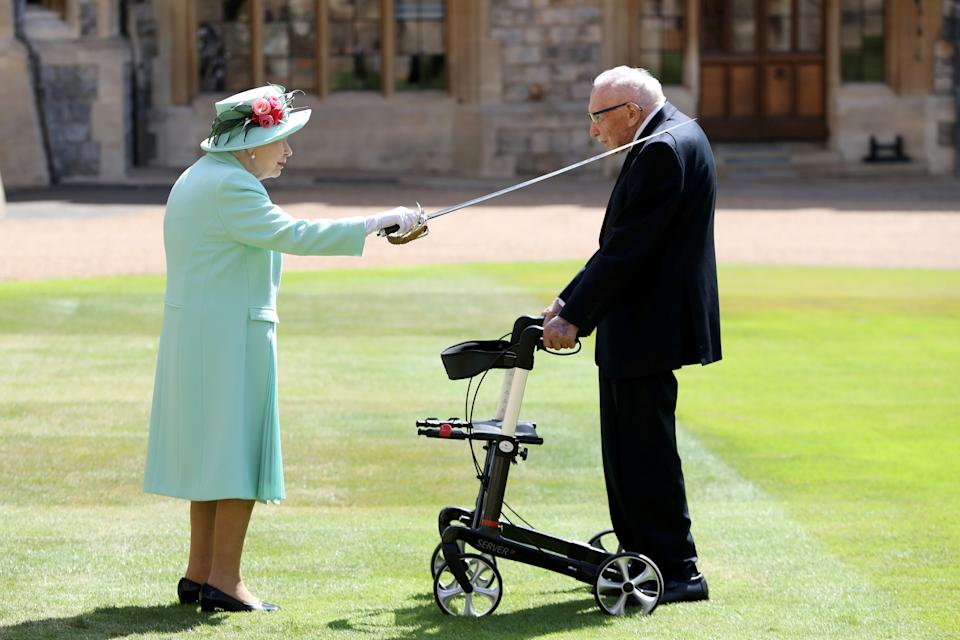 Britain's Queen Elizabeth awards Captain Tom Moore with the insignia of Knight Bachelor at Windsor Castle, in Windsor, Britain July 17, 2020. Chris Jackson/Pool via REUTERS     TPX IMAGES OF THE DAY