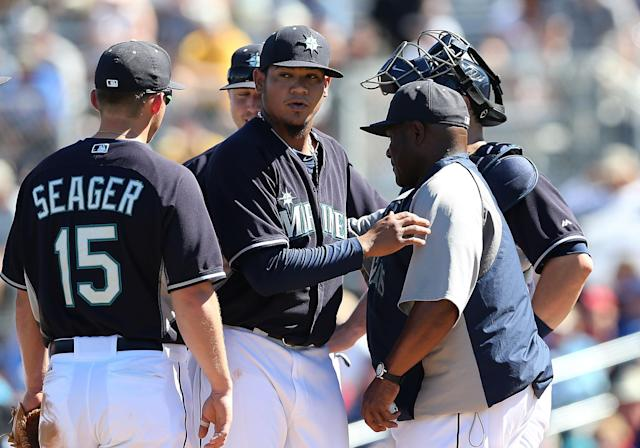 PEORIA, AZ - MARCH 09: Starting pitcher Felix Hernandez #34 of the Seattle Mariners is removed by manager Lloyd McClendon #23 during the spring training game against the Texas Rangers at Peoria Stadium on March 9, 2014 in Peoria, Arizona. (Photo by Christian Petersen/Getty Images)