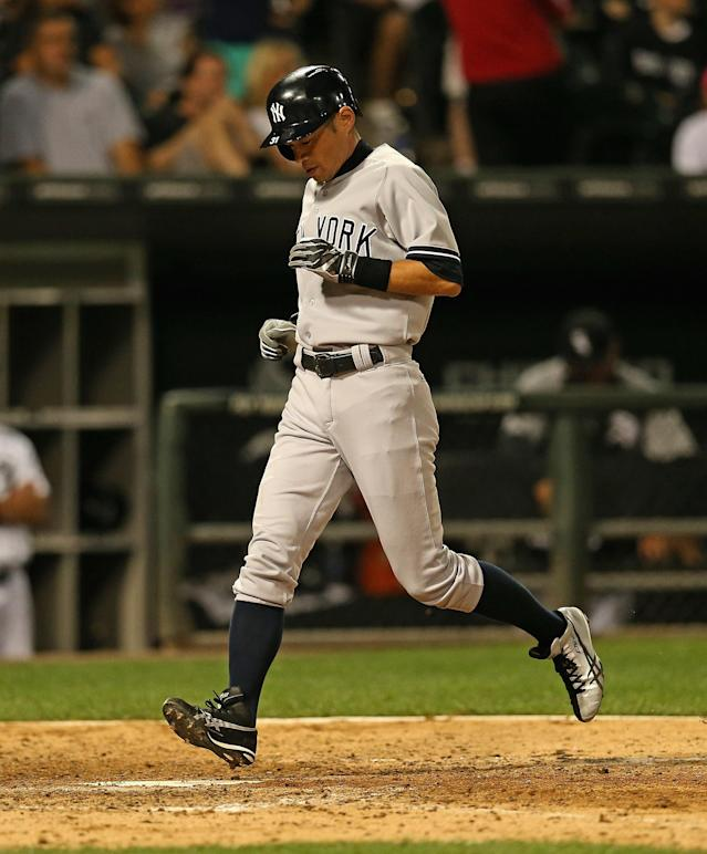 CHICAGO, IL - AUGUST 06: Ichiro Suzuki #31 of the New York Yankees scores a run in the 9th inning after hitting a pinch-hit single against the Chicago White Sox at U.S. Cellular Field on August 6, 2013 in Chicago, Illinois. The White Sox defeated the Yankees 3-2. (Photo by Jonathan Daniel/Getty Images)