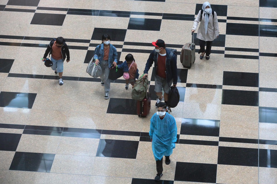 Travellers in the transit hall at Changi International Airport on September 8, 2021 in Singapore.  (Photo by Suhaimi Abdullah/NurPhoto via Getty Images)