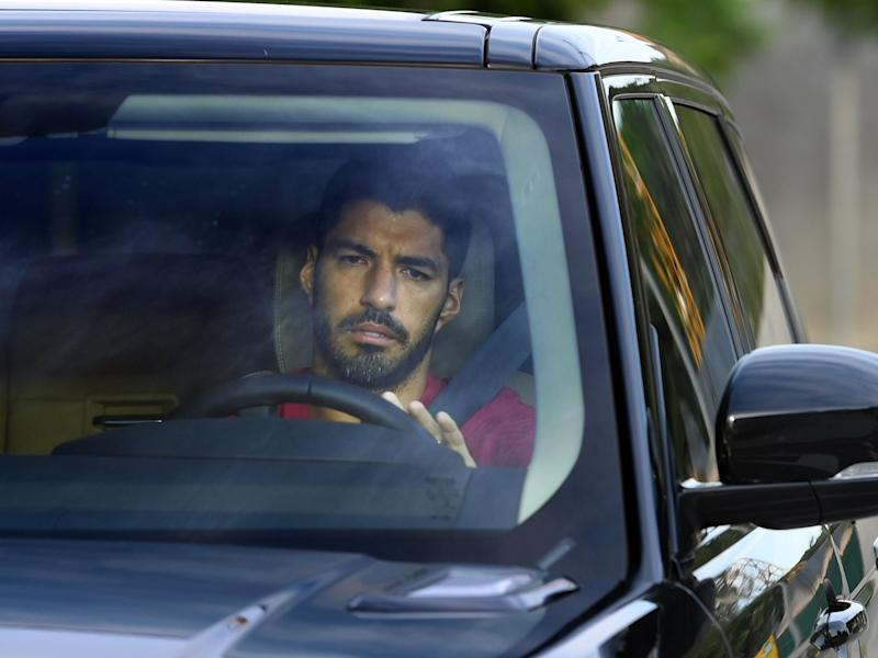 Luis Suarez arrives for one of his final training sessions (AFP via Getty Images)